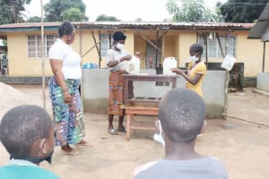 The Water Project: Lungi, Suctarr, #1 Kabbia Lane -  Participants Build Tippy Taps