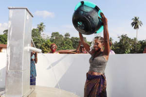 The Water Project: Lokomasama, Conteya Village -  Woman Happily Pouring Water On Herself