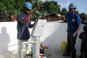 The Water Project: Lokomasama, Rotain Village -  Maintenance Officer Collects Water After Installation