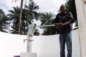 The Water Project: Lokomasama, Rotain Village -  Collecting Water