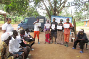 The Water Project: Lokomasama, Rotain Village -  Participants Display And Explain Disease Transmission Story