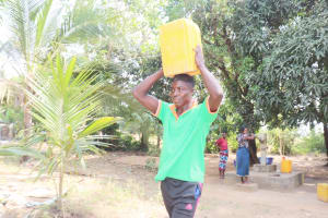 The Water Project: Lungi, Yongoroo, 32 Gbainty Bunlor -  Community Member Carrying Water