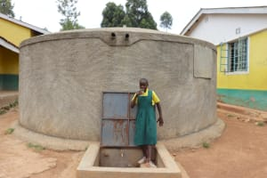 The Water Project: Koitabut Primary School -  Velma Taking A Drink From The Rain Tank