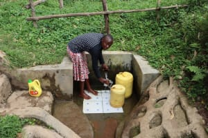 The Water Project: Ngeny Barak Community, Ngeny Barak Spring -  Gloria Fetching A Drink