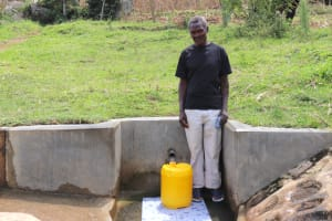 The Water Project: Bungaya Community, Charles Khainga Spring -  Mr Charles Khainga Fetching Water