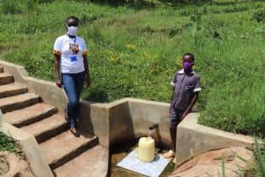 The Water Project: Emmachembe Community, Magina Spring -  Joseph And Field Officer Olivia