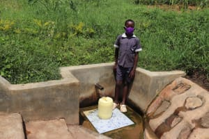 The Water Project: Emmachembe Community, Magina Spring -  Joseph Fetching Water