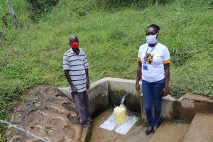 The Water Project: Shikangania Community, Abungana Spring -  Jared And Field Officer Olivia Bomji