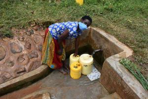 The Water Project: Shivembe Community, Murumbi Spring -  Margret Murumbi Fetching Water