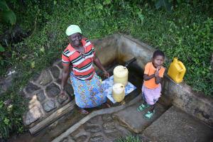 The Water Project: Munenga Community, Burudi Spring -  Christine Fetching Water