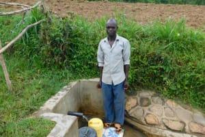 The Water Project: Eshiakhulo Community, Kweyu Spring -  Herbert Fetching Water