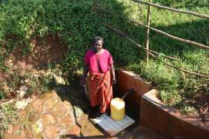 The Water Project: Emulembo Community, Gideon Spring -  Emi Adisa Fetches Water At Gideon Spring