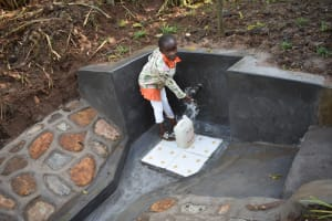 The Water Project: Musango Commnuity, Wabuti Spring -  Mary Splashing Water