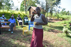 The Water Project: Musango Commnuity, Wabuti Spring -  Rosemary Demonstrating How To Brush Your Teeth