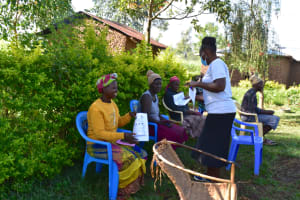 The Water Project: Musango Commnuity, Wabuti Spring -  Handing Out Covid Prevention Pamphlets