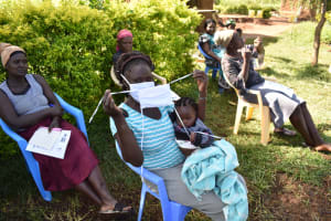 The Water Project: Musango Commnuity, Wabuti Spring -  Participant Receiving A Mask
