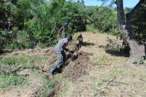 The Water Project: Indulusia Community, Osanya Spring -  Digging The Drainage Channel