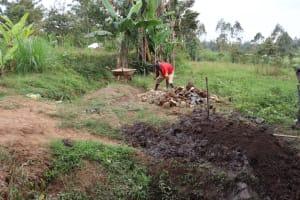 The Water Project: Shianda Community, Panyako Spring -  Assembling Local Materials