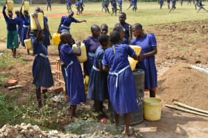 The Water Project: Mwikhupo Primary School -  Students Deliver Water For Construction