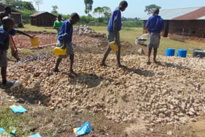 The Water Project: Mwikhupo Primary School -  Students Deliver Water To Mix Concrete