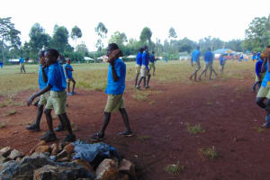 The Water Project: Kitagwa Primary School -  Students Bring Materials To Construction Site