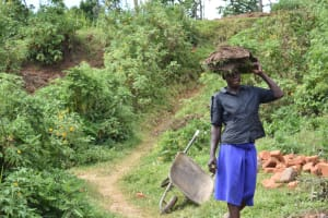 The Water Project: Maraba Community, Shisia Spring -  Woman Carrying Grass To Plant At The Spring