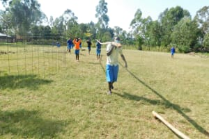 The Water Project: St. Peter's Ebunga'le Primary School -  Pupils Carrying Poles For Tank Dome Supports