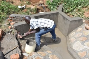 The Water Project: Maraba Community, Shisia Spring -  Plastering The Walls