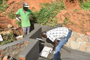 The Water Project: Maraba Community, Shisia Spring -  Setting The Tiles