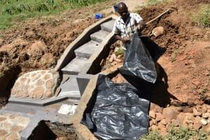 The Water Project: Maraba Community, Shisia Spring -  Placing The Tarp