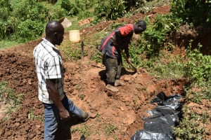 The Water Project: Maraba Community, Shisia Spring -  Backfilling With Soil