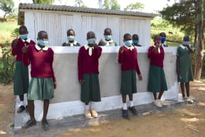 The Water Project: Wavoka Primary School -  Girls Posing At Their New Latrines