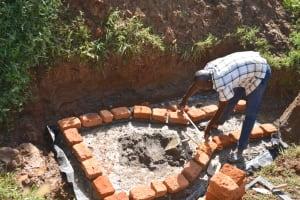 The Water Project: Maraba Community, Shisia Spring -  Bricklaying Begins