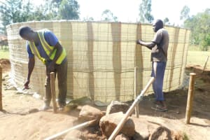 The Water Project: St. Peter's Ebunga'le Primary School -  Tying Sugar Sacks To Wire Walls
