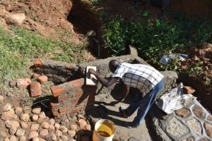 The Water Project: Maraba Community, Shisia Spring -  Cementing The Walls
