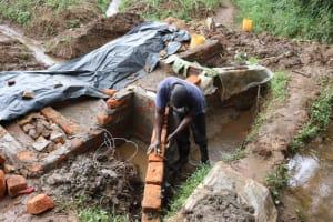 The Water Project: Mukhonje B Community, Peter Yakhama Spring -  Constructing Wing Walls