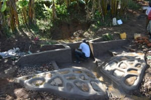 The Water Project: Mukhonje B Community, Peter Yakhama Spring -  Plastering The Outer Walls