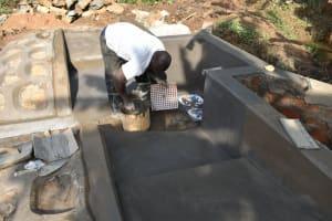 The Water Project: Mukhonje B Community, Peter Yakhama Spring -  Setting The Tiles