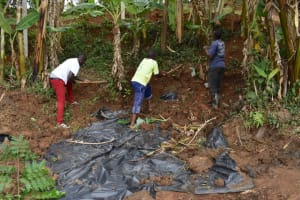 The Water Project: Mukhonje B Community, Peter Yakhama Spring -  Backfilling With Soil