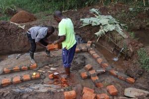 The Water Project: Mukhonje B Community, Peter Yakhama Spring -  Bricklaying Begins