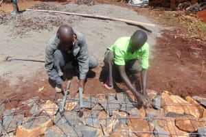 The Water Project: Kitagwa Secondary School -  Placing The Tap And Drainage Pipes