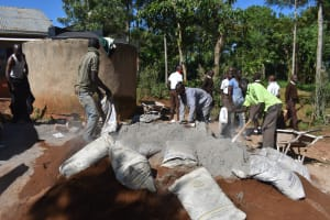The Water Project: Kitagwa Secondary School -  Community Members Mix Cement And Concrete