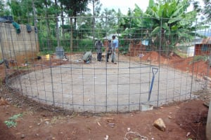 The Water Project: Kitagwa Secondary School -  Attaching Wire Wall To Foundation