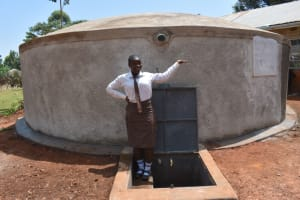 The Water Project: Kitagwa Secondary School -  Posing With A Glass Of Clean Water From The Tank