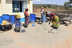 The Water Project: Kaketi Secondary School -  Mixing Cement And Sand