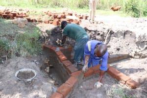 The Water Project: Kalenda A Community, Moro Spring -  Raising The Walls