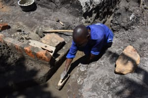 The Water Project: Kalenda A Community, Moro Spring -  Plastering The Drainage Channel Exit