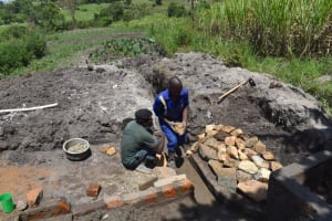 The Water Project: Kalenda A Community, Moro Spring -  Arraging Stones For The Rub Walls