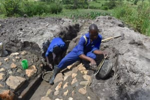 The Water Project: Kalenda A Community, Moro Spring -  Plastering The Stone Pitching