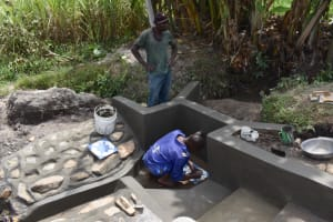 The Water Project: Kalenda A Community, Moro Spring -  Setting The Tiles In Place